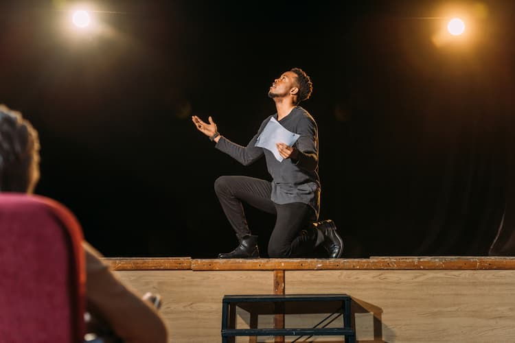 Actor performing onstage for director