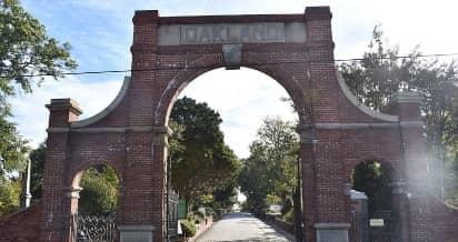 The brick gate entrance to historic Oakland Cemetery in Atlanta.